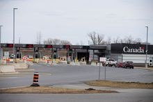 Cars drive through Canadian customs after movement restrictions came into effect due to the coronavirus outbreak in the border town of Cornwall, Ont., on March 25, 2020.