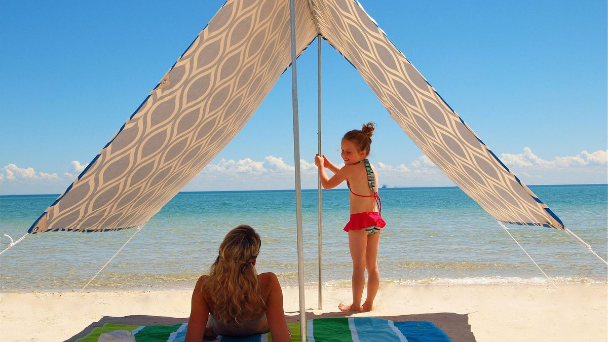 Sun shade Ditch that unruly beach umbrella and take cover under Hollie and Harrie's Sombrilla. Designed in Australia in such bright patterns as Moroccan Blue and French Stripe, the stylish all-cotton, 95% UV-protected canopy is big enough to shield the whole family. When you're done for the day, roll it up into a carrying case that's slightly bigger than a yoga mat. $150 ($157 Cdn); hollieandharrie.com.au