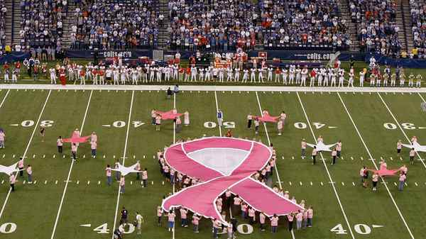 A breast-cancer awareness banner is displayed before a game at Indianapolis's Lucas Oil Stadium on Oct. 10.