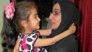 Shoreh Pirani, widow of the slain Iranian electrical engineer Darioush Rezaeinejad, holds her daughter Armita.