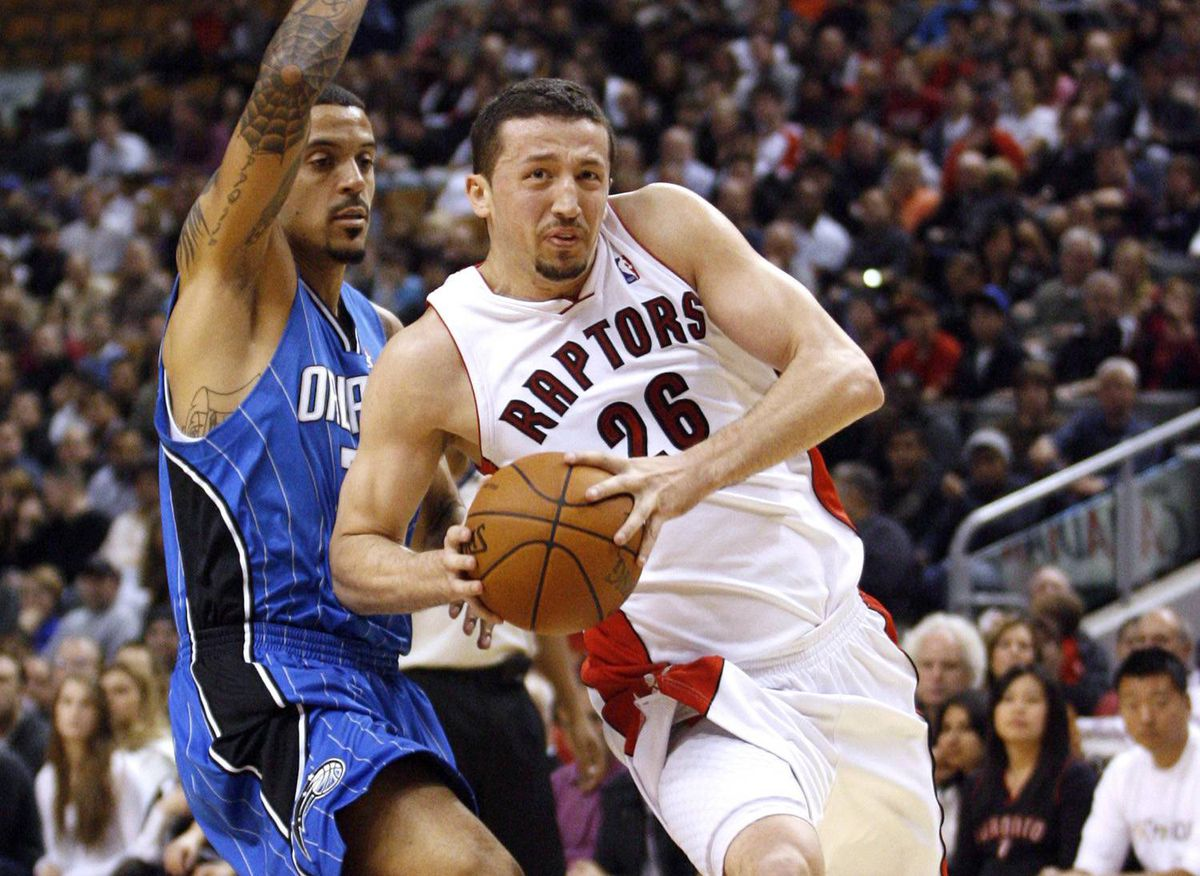 Toronto Raptors forward Hedo Turkoglu drives to the basket past Orlando Magic forward Matt Barnes, left, during the first half of their NBA basketball game in Toronto November 1, 2009.