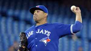 Toronto Blue Jays pitcher Ricky Romero throws against the Boston Red Sox during the first inning on April 11, 2012. Romero earned the win, allowing one run through eight and a half innings.