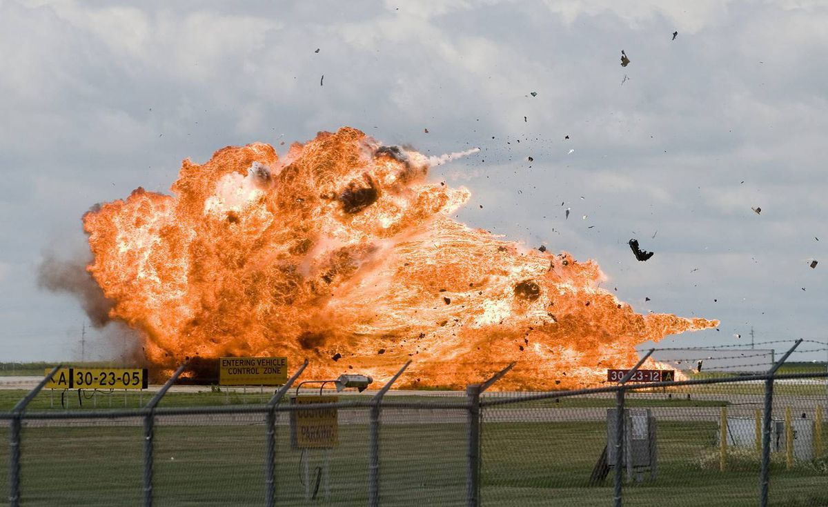A CF-18 fighter jet explodes as it crashes during a practice flight for this weekend's Alberta International AirShow in Lethbridge, Alta., at the Lethbridge County Airport. The pilot ejected before impact.