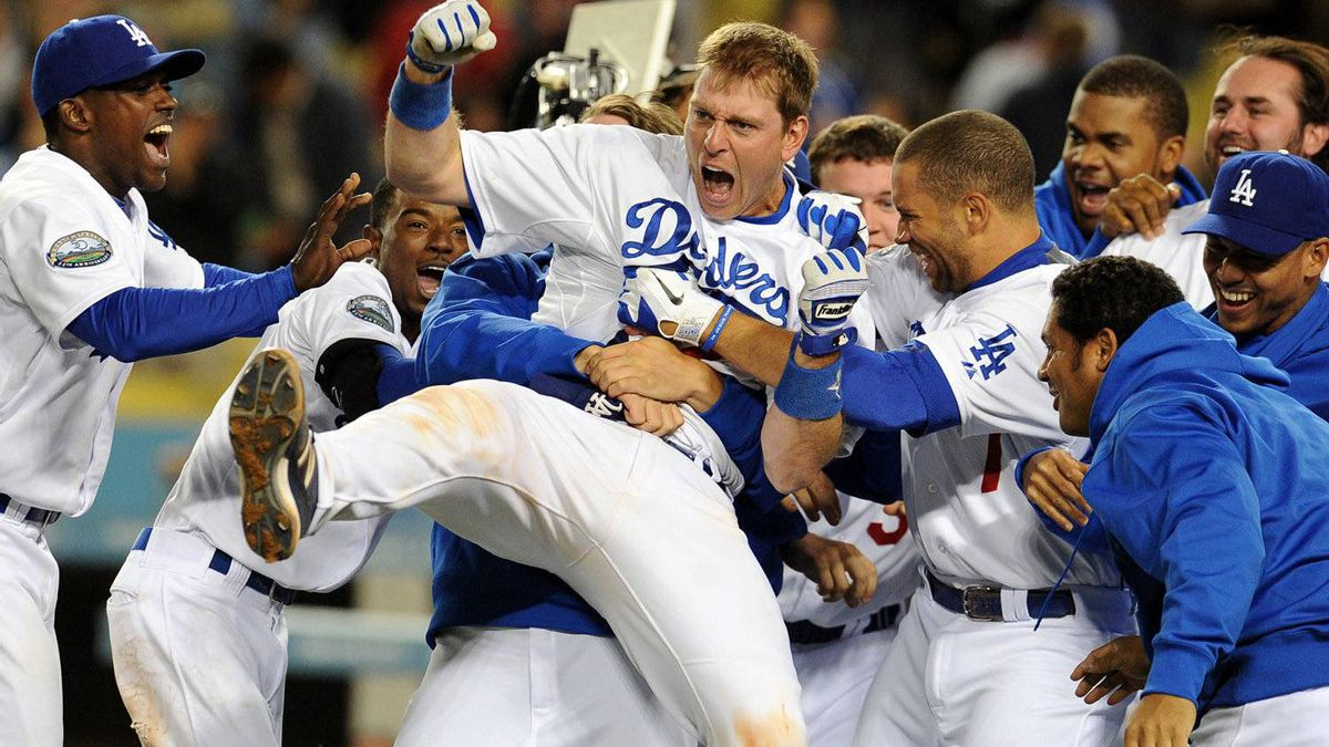 Los Angeles Dodgers' A.J. Ellis is mobbed at home plate by teammates after hitting a three run home run to beat the Houston Astros 6-3 in the ninth inning of a baseball game in Los Angeles on Saturday, May 26, 2012. (AP Photo/Keith Birmingham, Pasadena Star-News)
