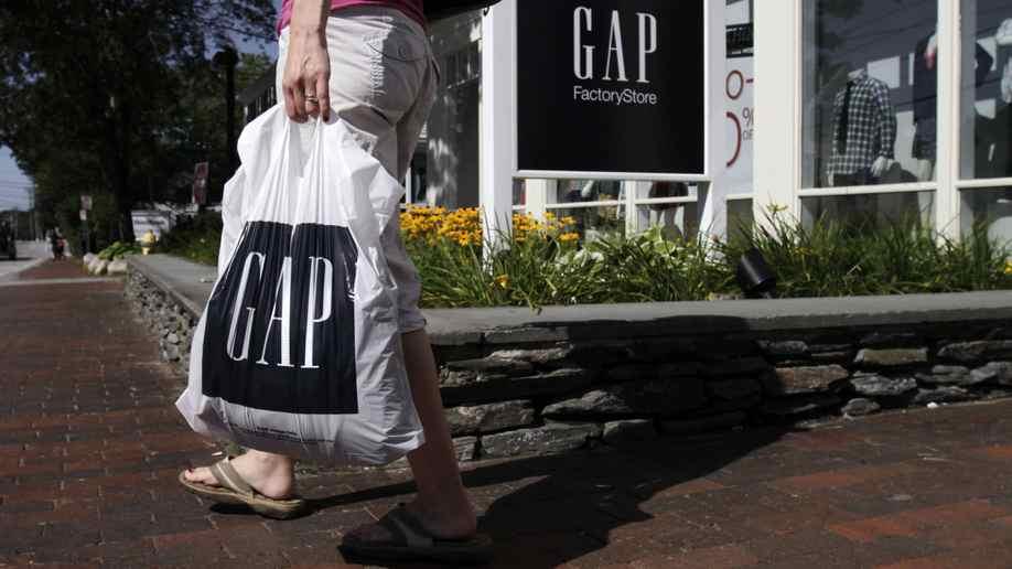 A shopper leaves a Gap store in Freeport, Maine.