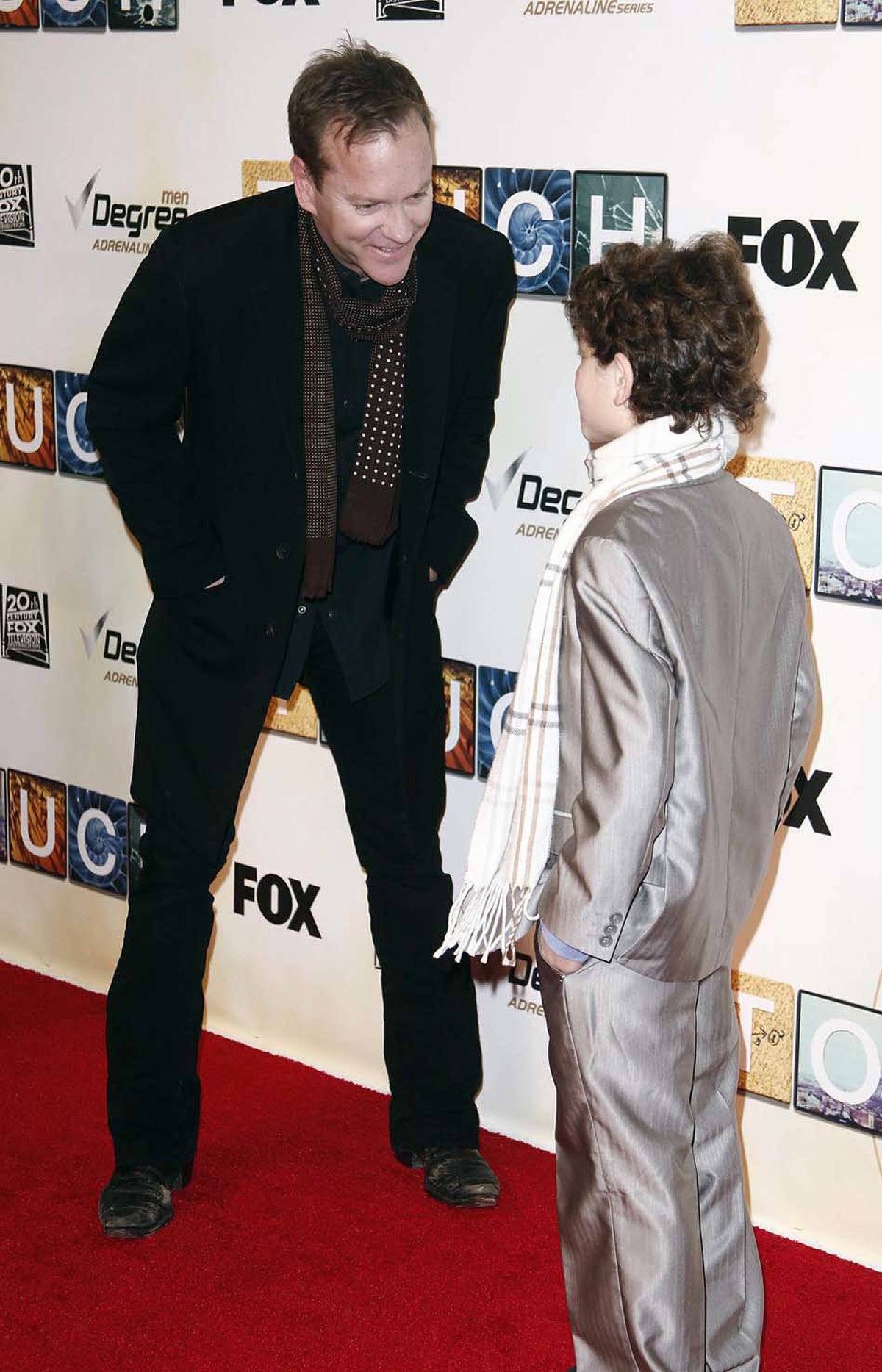 Actor Kiefer Sutherland (left) gently explains to his nattily attired young costar David Mazouz that when he has worked in show business for 30 years and carried an internationally syndicated hit series for a network for eight seasons, he too can try to dress like the star of the goddamn show. Punk.