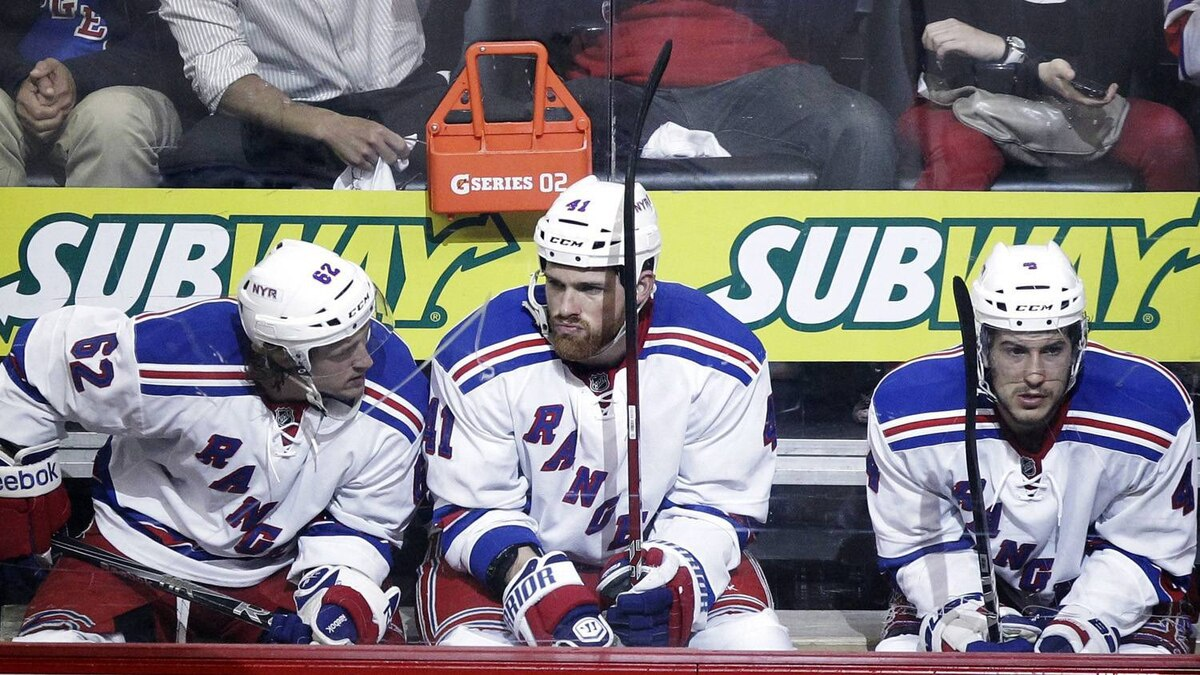 From left, New York Rangers' Carl Hagelin, of Sweden, Stu Bickel and Michael Del Zotto sit in the penalty box following a scuffle against the New Jersey Devils during the third period of Game 4 of an NHL hockey Stanley Cup Eastern Conference final playoff series, Monday, May 21, 2012, in Newark, N.J. The Devils won 4-1. (AP Photo/Julio Cortez)