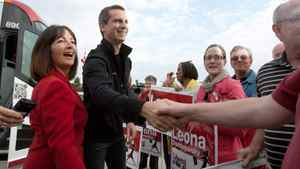 Premier Dalton McGuinty and Prince Edward Hastings MPP Leona Dombrowsky shake hands with supporters outside the Kellogg factory in Belleville, Ontario on September 21, 2011.