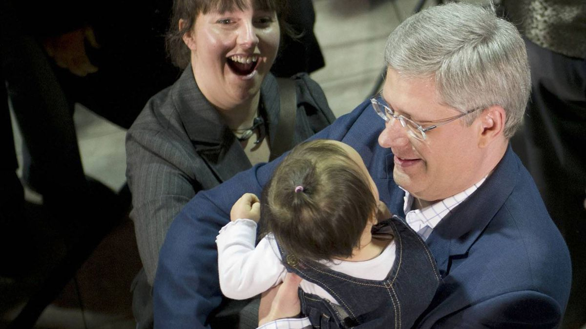 A mother watches as Conservative Leader Stephen Harper holds her baby during a campaign event in Drummondville, Que. Sean Kilpatrick/The Canadian Press