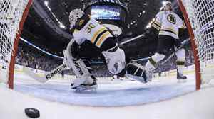 Boston Bruins goalie Tim Thomas reacts to the game-winning goal by Vancouver Canucks Alex Burrows (not seen) during overtime in Game 2 of the NHL Stanley Cup hockey playoff in Vancouver on Saturday.