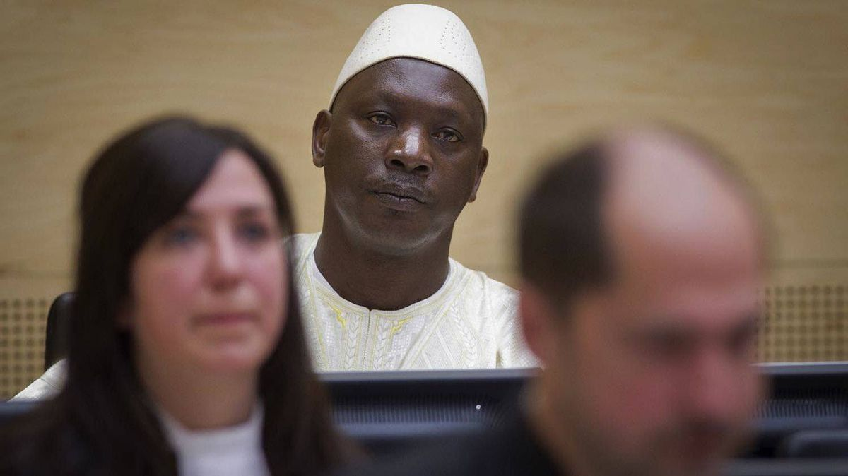 Congolese warlord Thomas Lubanga, centre, awaits his verdict in the courtroom of the International Criminal Court in The Hague on March 14, 2012.