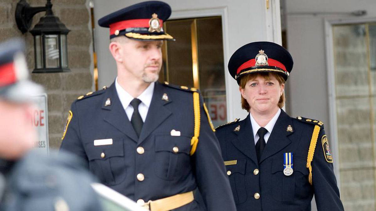 Belleville's Chief of Police Cory McMullan, right, leaves John R. Bush funeral home after attending the funeral for Jessica Lloyd on Feb. 12, 2010.