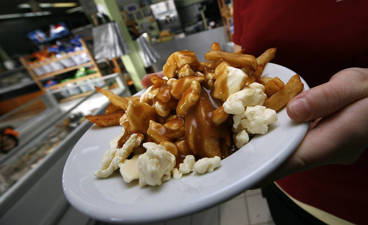 Poutine - Fernand Lachance, a cafe owner in Warwick, Que., assembled its foundation in 1957 for a trucker craving both French fries and curds. Jean-Paul Roy, a restaurateur in Drummondville, Que., added gravy to complete the dish. Poutine has since sneakily cropped up in eateries across the country and past our borders, inspiring such (questionable) variations on the classic toppings as bacon, peas and barbecue sauce.