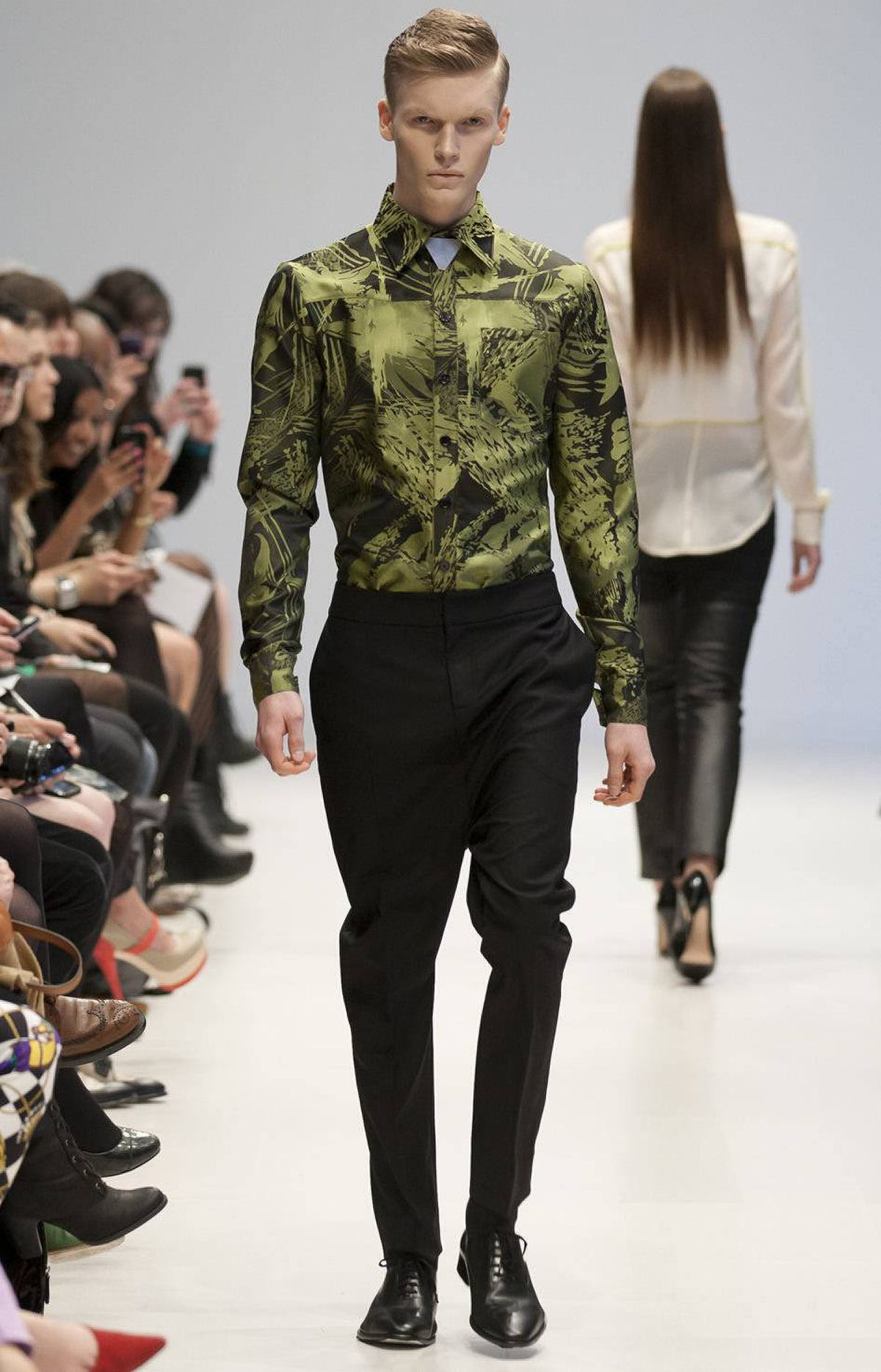 There was something for guys, too. A leafy printed dress shirt and drop-crotch trousers were particularly notable and worked. More directional sheer tops with vests for men, though, were a bit forward. But take the pieces apart from the styling, however, and the men's separates stood out on their own.