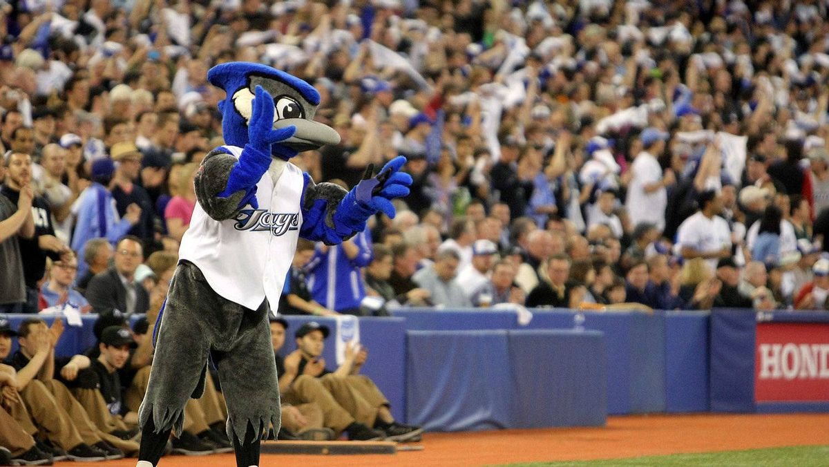 BJ Birdie cheers as members of the Toronto Blue Jays run on to the field as they prepare to play against the Minnesota Twins on opening day during their MLB game at the Rogers Centre April 1, 2011 in Toronto, Ontario, Canada.