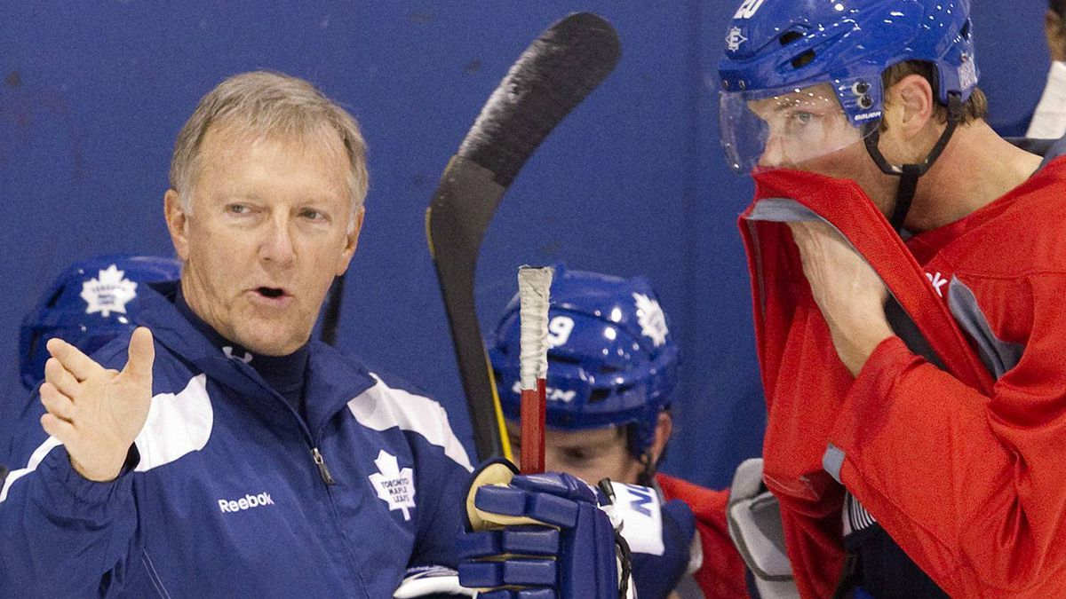 Toronto Maple Leafs Head Coach Ron Wilson (left) offers advice to new signing David Steckel during the final practice session Toronto on Wednesday October 5, 2011, ahead of tomorrow's season opener against Montreal Canadiens. Photo by Chris Young for The Globe and Mail