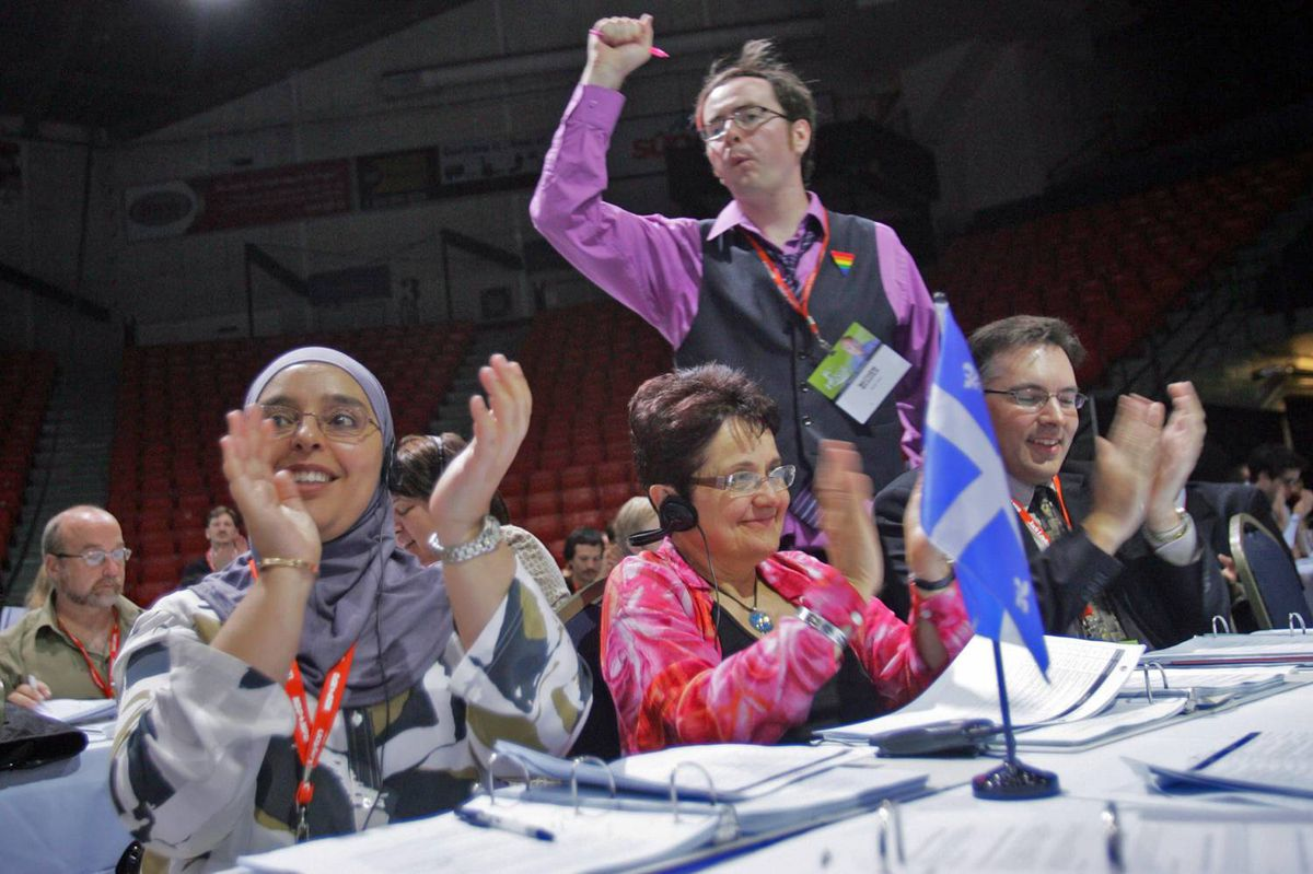 Quebec delegates celebrate after a successful vote during policy debates at the convention on Saturday.
