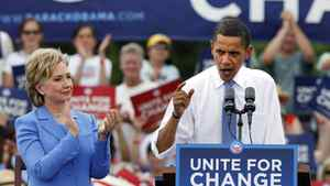 Barack Obama speaks as Hillary Rodham Clinton applauds at a campaign event in Unity, N.H. Friday, June 27, 2008, during their first joint public appearance since the divisive Democratic primary race ended.