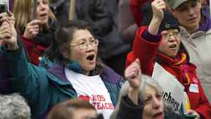 Demonstrators react while listening to B.C .Teachers' Federation President Susan Lambert speech during a rally in Vancouver, British Columbia March 7, 2012.