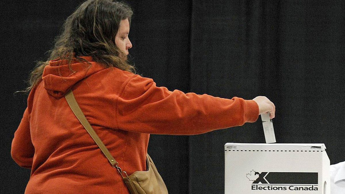 A Charlottetown voter caster her ballot in the federal election on May 2, 2011.