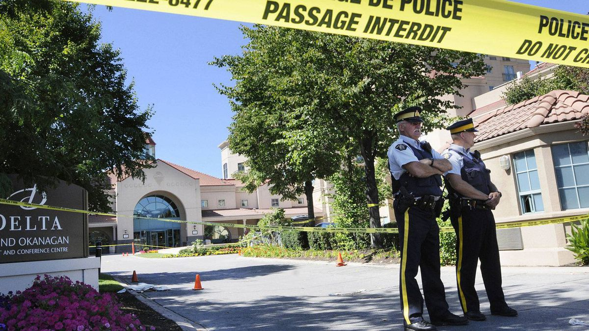 RCMP members guard the scene at the Delta Grand Hotel in Kelowna, B.C., on Tuesday, Aug. 16, 2011 where a brazen gangland-style shooting took place.