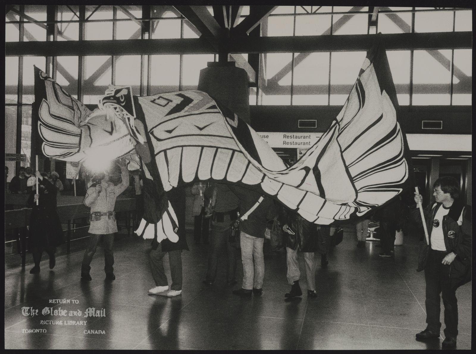 INDIANS Canada Haida Members of caravan hold aloft Haida eagle banner at Ottawa railway station yesterday.