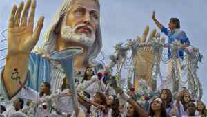 Brazilian singer Roberto Carlos waves from atop a float of the samba school Beija Flor on the Sambadrome.