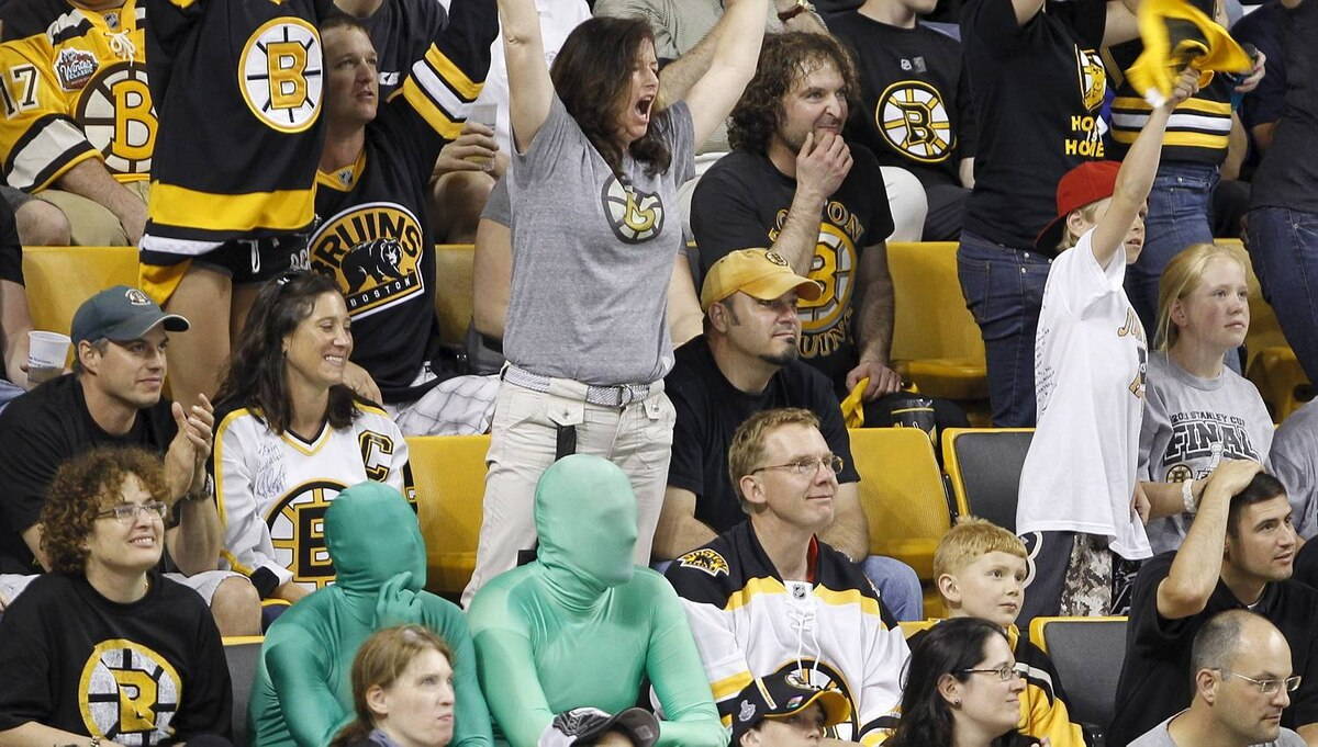 The green men don't look very enthusiastic during the second period of Game 4 of the NHL Stanley Cup Final series between the Boston Bruins and the Vancouver Canucks in Boston on June 8, 2011. (Photo by Peter Power/The Globe and Mail)