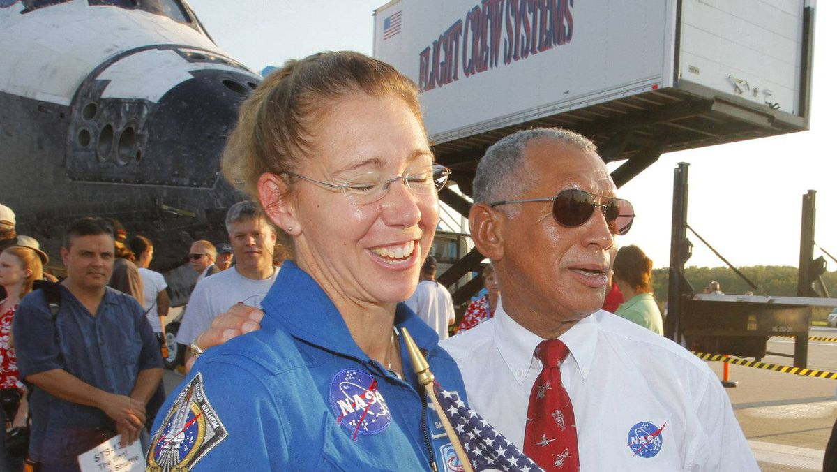 NASA Administrator Charles Bolden (R) greets space shuttle Atlantis mission specialist Sandy Magnus (L) on the runway on July 21, 2011 at Kenedy Space Center in Florida after Atlantis landed.