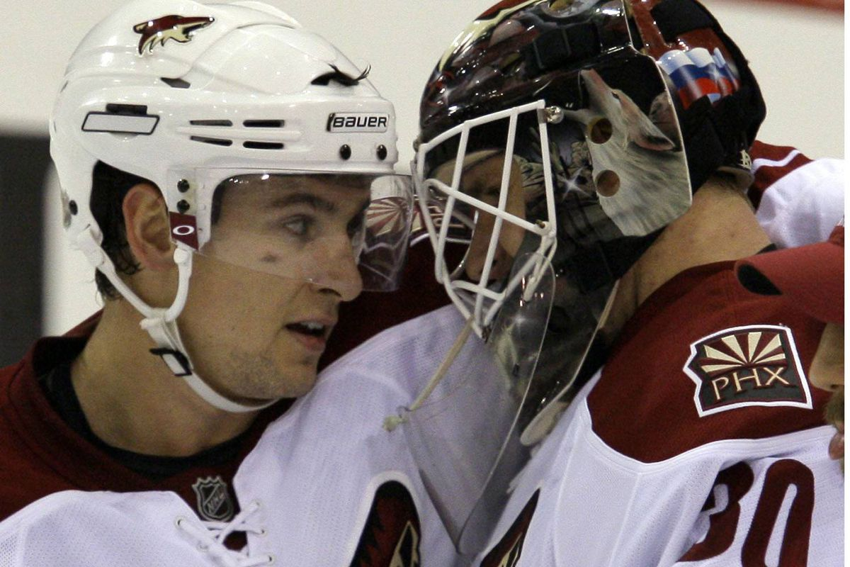 Phoenix Coyotes forward Scottie Upshall and goaltender Ilya Bryzgalov celebrate their club's 3-0 win over the Pittsburgh Penguins on Wednesday night.