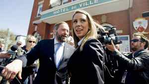 Ruth Ellen Brosseau, the NDP MP for the riding of Berthier-Maskionge, leaves city hall in Louiseville, Que., on May 11, 2011, with deputy leader Thomas Mulcair.