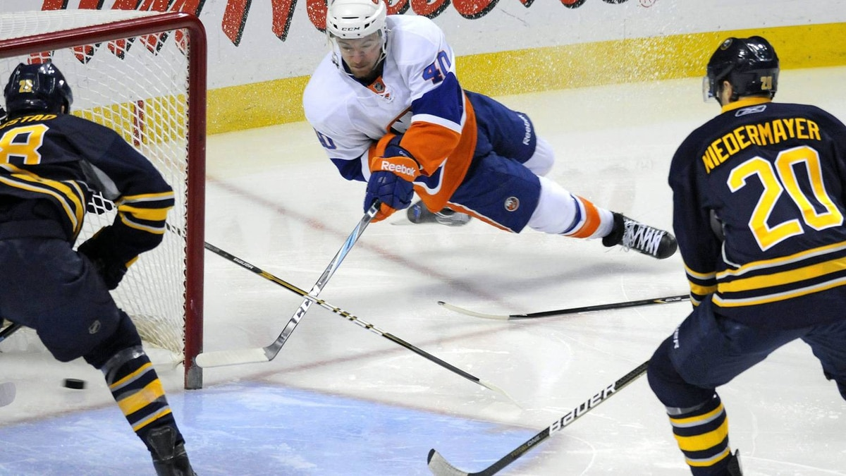 New York Islanders winger Michael Grabner, center, scores a goal as Buffalo Sabres center Paul Gaustad, left, and Sabres' Rob Niedermayer look on during the first period of an NHL hockey game, Sunday, Feb. 13, 2011, in Buffalo, N.Y. The Islanders won 7-6 in overtime. (AP Photo/ Don Heupel)