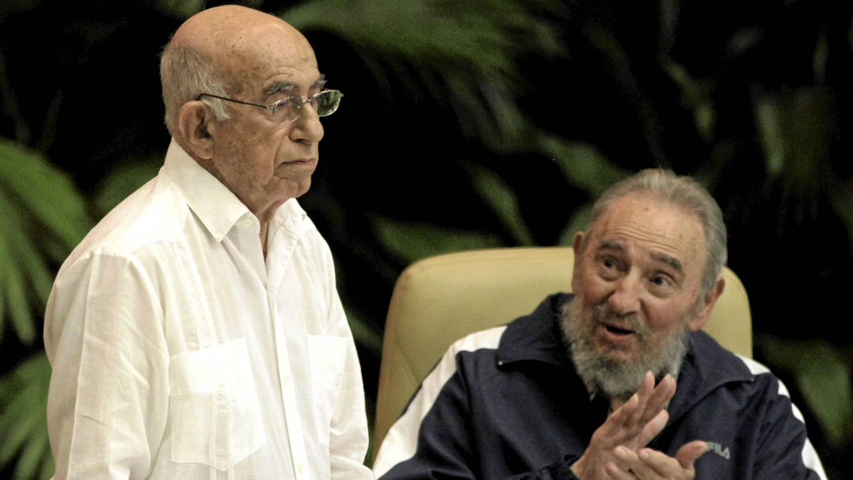 Cuba's Vice President Jose Ramon Machado Ventura, left, is applauded by Fidel Castro after being elected as secretary of Cuba's Communist Party in Havana, April 19, 2011.