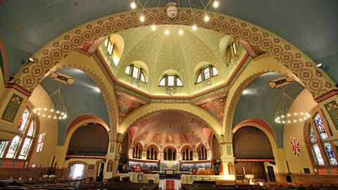 inside St. Anne's Church on Gladstone Avenue in Toronto, which is unique for its Byzantine-style dome and Group of Seven paintings featured throughout the church.