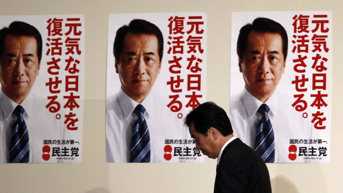 Japan's Prime Minister Naoto Kan attends a news conference at the Democratic Party of Japan election headquarters in Tokyo July 12, 2010. Voters dealt Japan's government a stinging blow in upper house elections on Sunday, a reverse that could thwart its ambitions to curb the country's massive public debt and threaten Kan's job