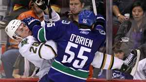 Vancouver Canucks' Shane O'Brien, right, checks Dallas Stars' Mark Fistric during third period NHL action in Vancouver on Thursday January 21, 2010.