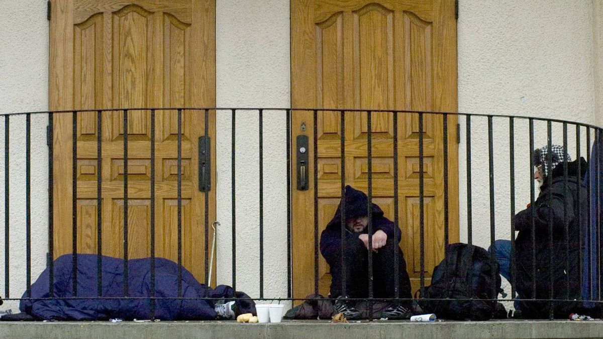 Homeless people sleep on a building's steps in the Victoria, July 2007.