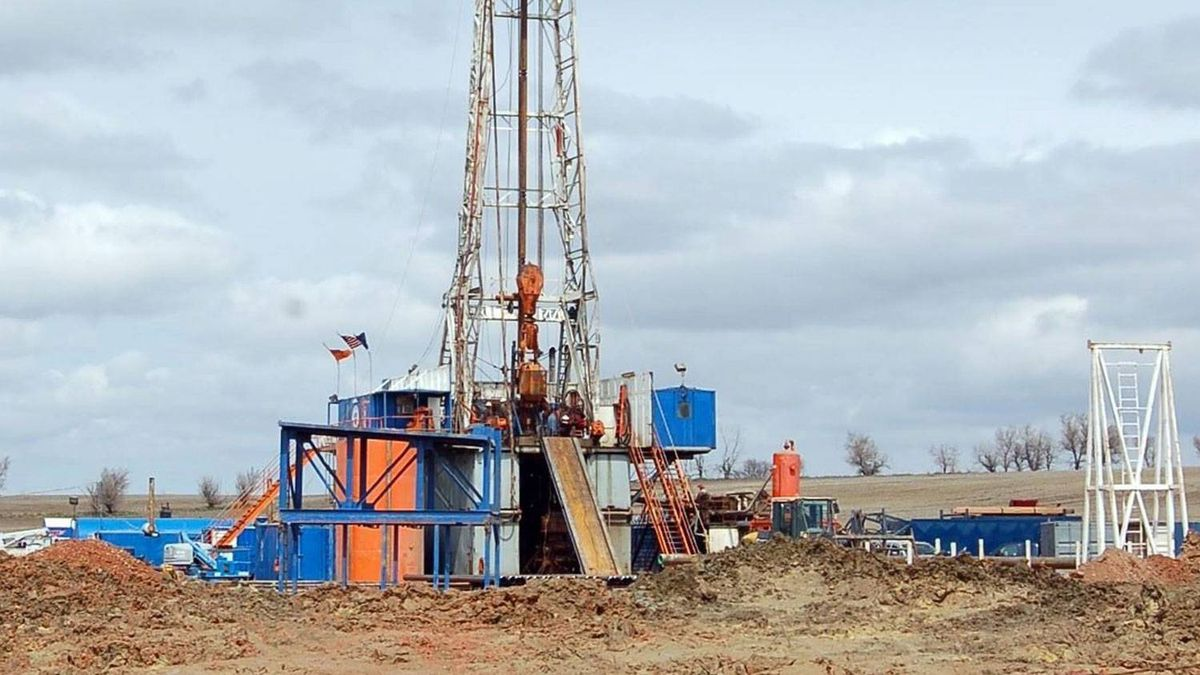 A drill rig owned by Enid, Okla.-based Continental Resources Inc. aims for oil from the Three Forks-Sanish formation near Watford City, N.D. Dozens of fruitful wells beneath the rich Bakken shale in North Dakota continue to fuel a hunch among oilmen and geologists that another vast crude-bearing formation may be buried in the state's vast oil patch.