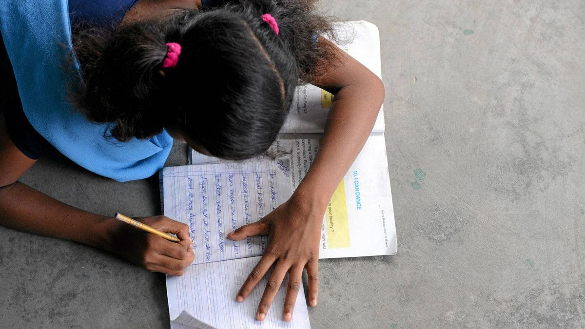 A student studies on the hallway floor at the Prerna Residential School for Mahadalit Girls in Jamsaut, in India's eastern Bihar state.