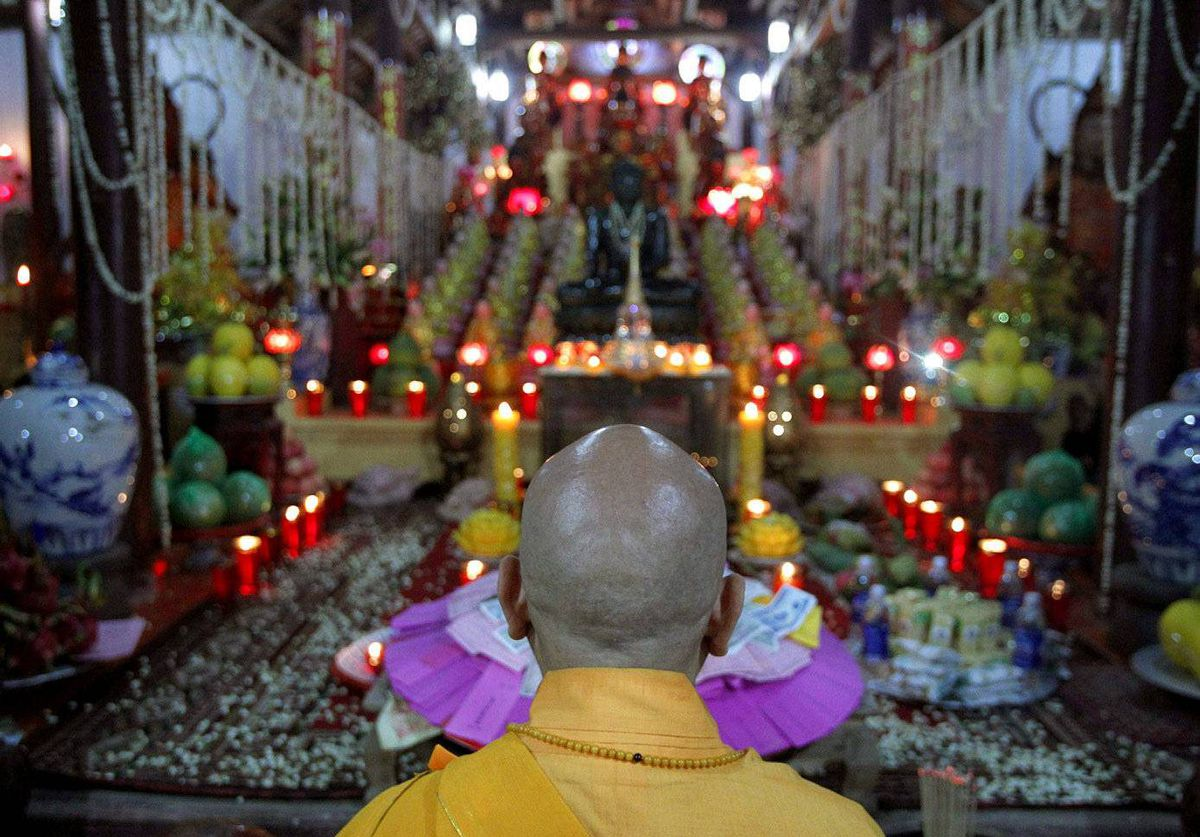 Buddhist monk Thich Hai Hoa prays during Vesak Day celebrations at Duoc Thuong pagoda, outside Hanoi. Vesak Day commemorates the birth, enlightenment and death of Buddha.
