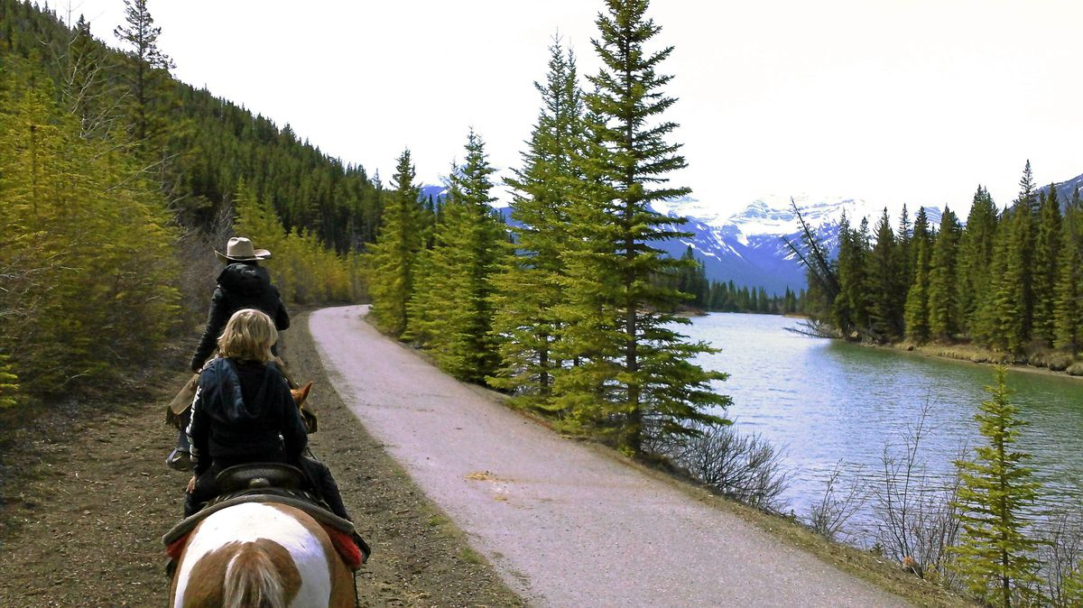 See Banff National Park from the back of a horse.