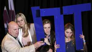 Supporters of Republican U.S. presidential candidate Mitt Romney hold up letters spelling his name at his Super Tuesday primary election night rally in Boston on March 6, 2012. REUTERS/Jessica Rinaldi (UNITED STATES - Tags: POLITICS ELECTIONS)