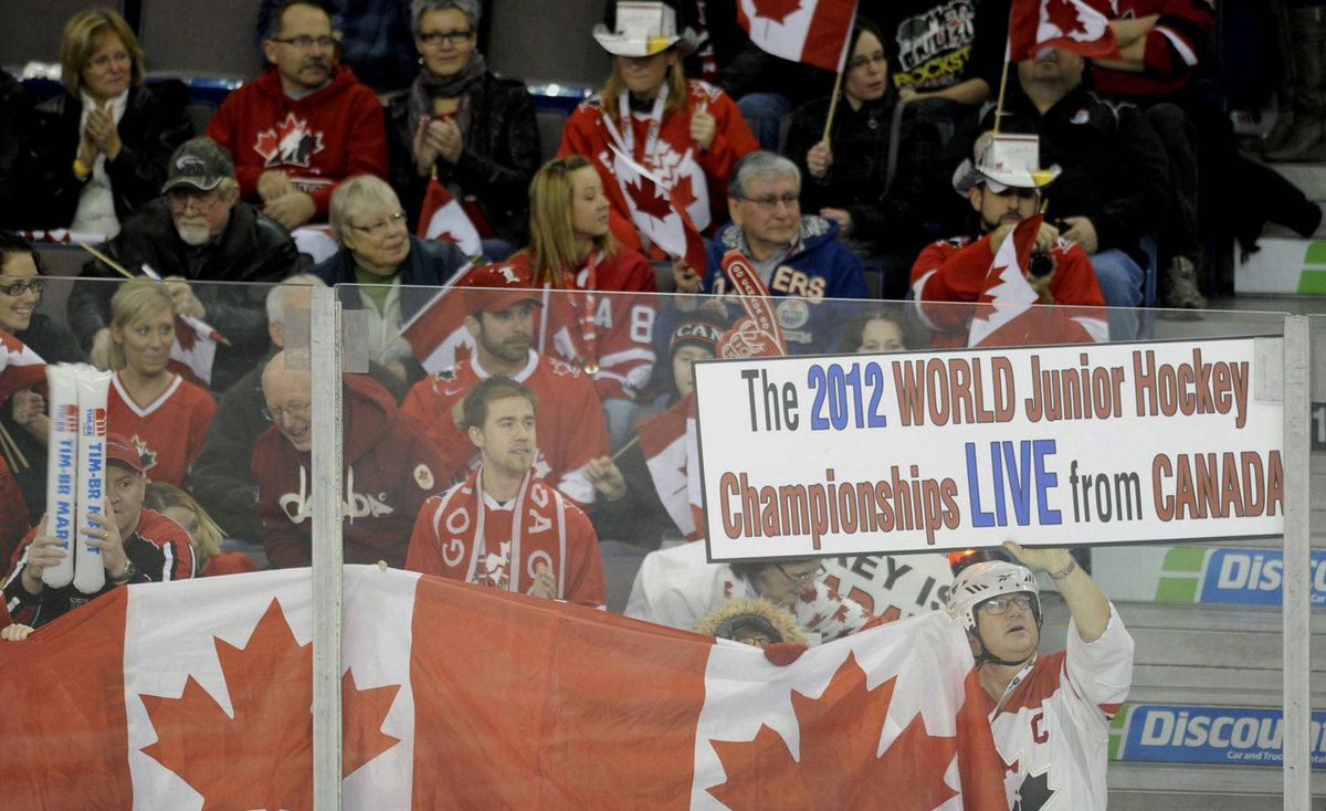 Canada fans celebrate during first period play against Denmark at the 2012 IIHF U20 World Junior Hockey Championships in Edmonton, Alberta, December 29, 2011.