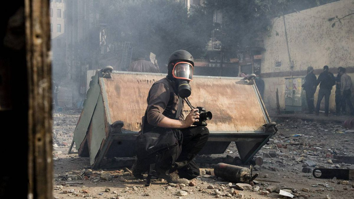 Undated photo of French photographer Remi Ochlik covering demonstrations in Cairo, who died Wednesday Feb. 22, 2012 in Homs, Syria.