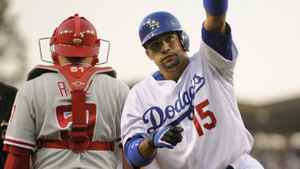 The Los Angeles Dodgers traded Rafael Furcal to the St. Louis Cardinals on Sunday. In this file photo, Furcal reacts in front of Philadelphia Phillies catcher after hitting a solo home run in the second inning in Game 3 of Major League Baseball's NLCS playoff series in Los Angeles October 12, 2008. REUTERS/Mark J. Terrill/Pool