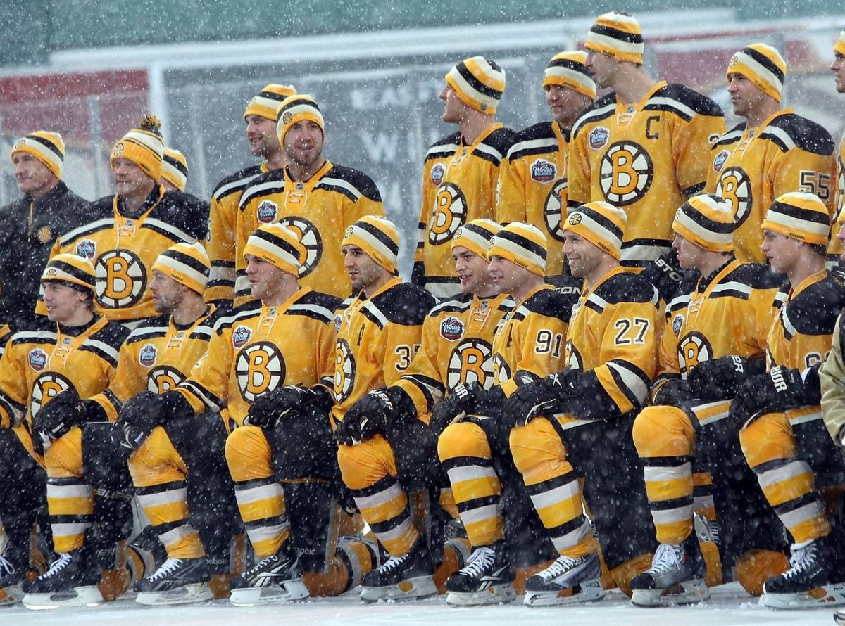 The Boston Bruins pose for a team pictures before the Bridgestone NHL Winter Classic on December 31, 2009 at Fenway Park in Boston, Massachusetts. (Photo by Elsa/Getty Images)