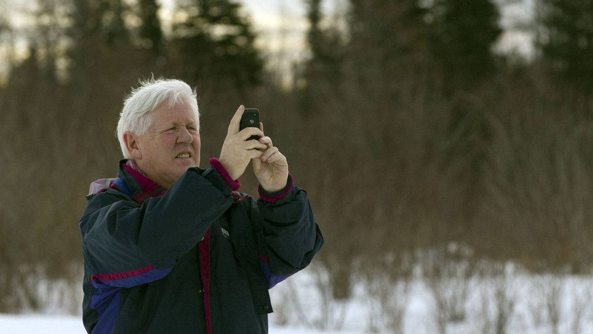 Liberal Leader Bob Rae takes photos during a visit in Atawapiskat, Ontario, Dec. 17, 2011. About 20 families will move into a temporary shelter on Dec. 23 to escape the housing crisis at the aboriginal reserve of Attawapiskat where many households live without running water or sanitary facilities, according to local media.