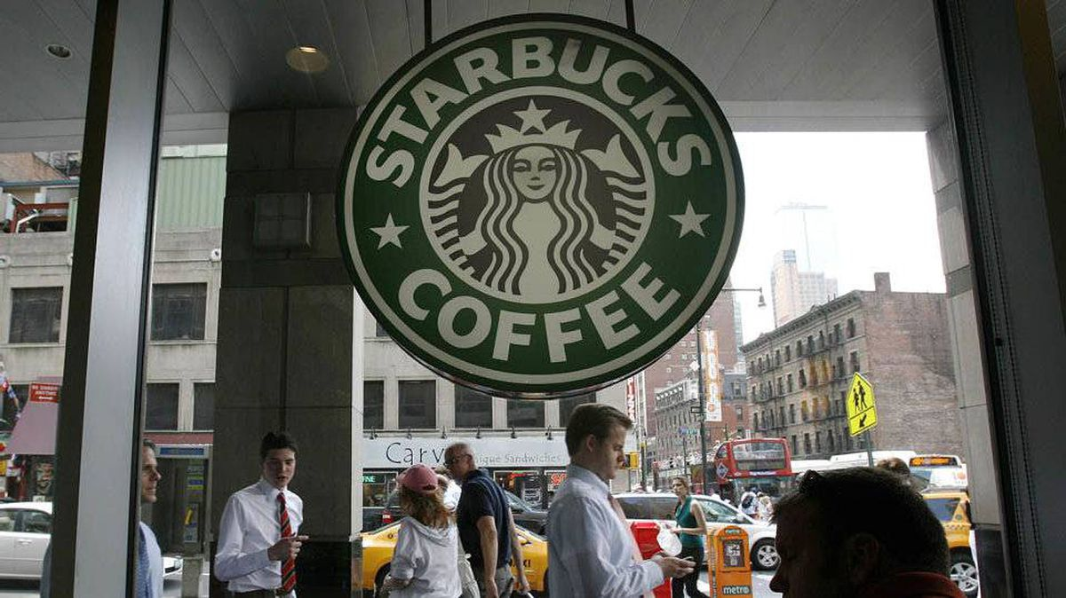 People walk past the Starbucks outlet on 47th and 8th Avenue in New York.