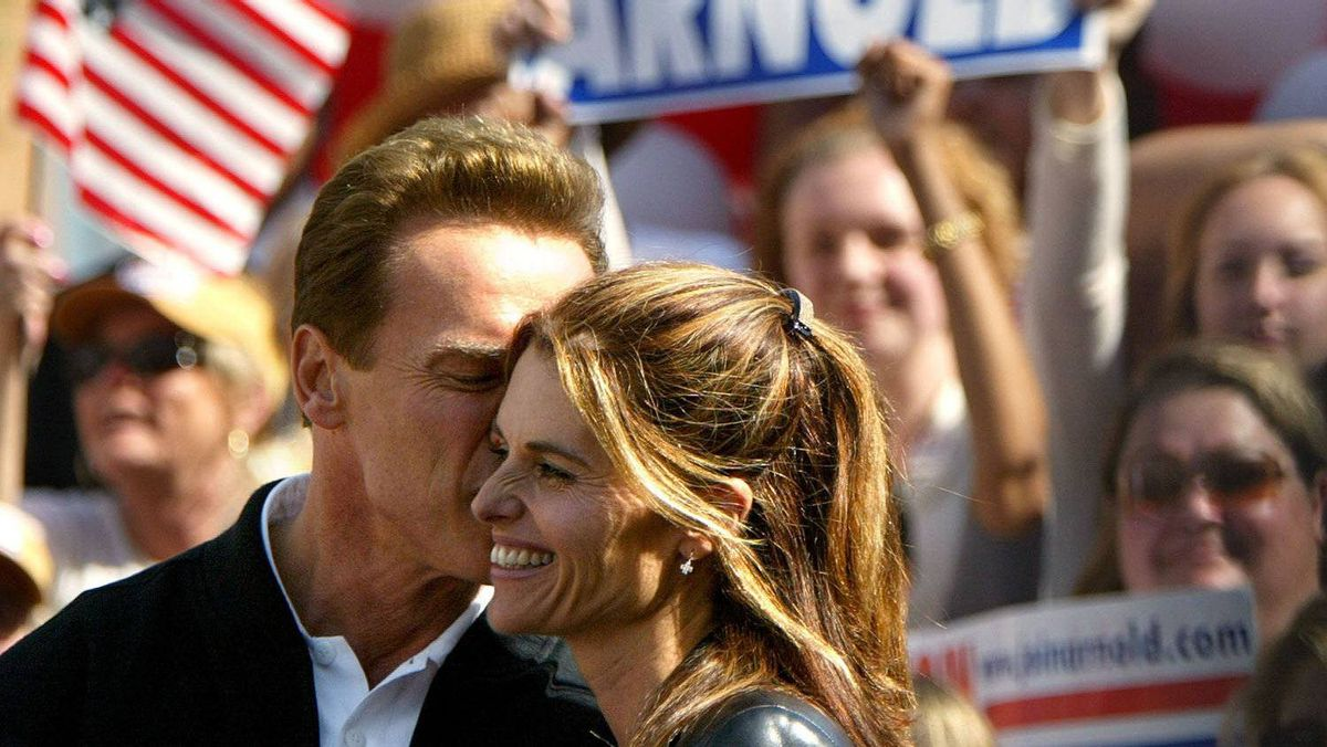 Republican gubernatorial candidate Arnold Schwarzenegger kisses his wife Maria Shriver during a rally October 4, 2003, in Modesto, California. Schwarzenegger continues on his four-day bus tour through California that began in San Diego and ends in Sacramento. There are six buses in the tour, all named after Schwarzenegger films.