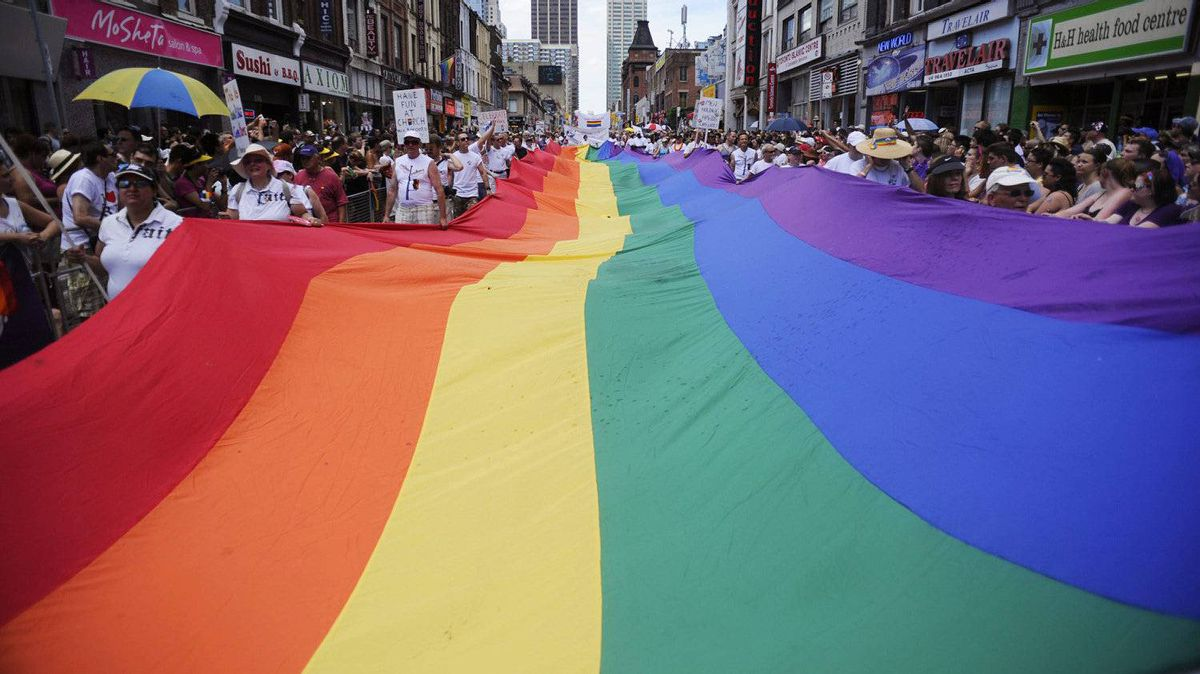 A giant rainbow flag - the longtime symbol of Pride and its cause - is pulled along the parade route.